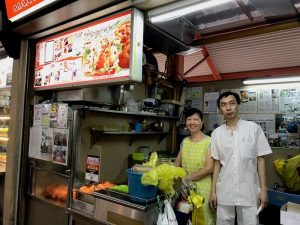 Famous Stall for Fried Oyster Pancakes at Maxwell Hawker Center. Crazy Rich Asians Singapore