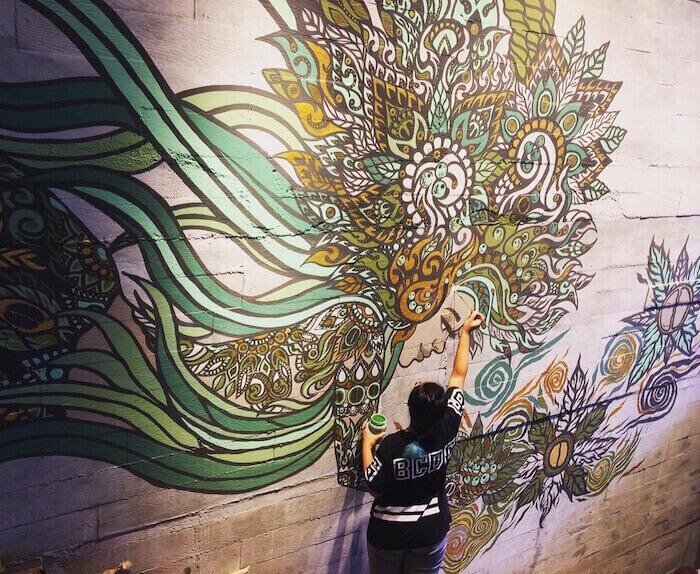 Lisa Mam Painting a Mural